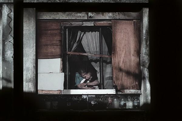 Julio Bittencourt In a Window of Prestes Maia 911 Building